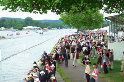 A crowd of people at the Regatta by the Thames