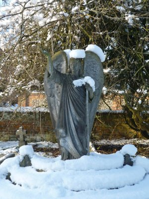Picture of a statue of an angel covered in snow