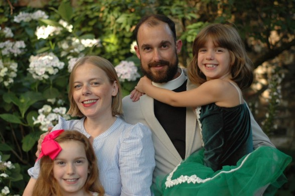An image of Father Jeremy and his wife and two daughters