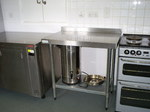 A  photo of the stainless steel surfaces and a tea urn inside